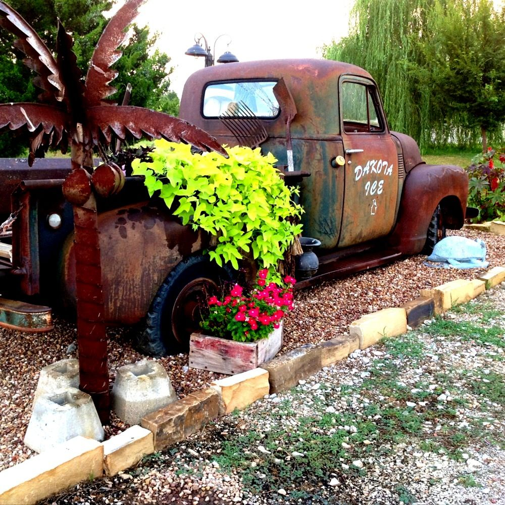 Old Truck With Palm Tree Yard Ornament.