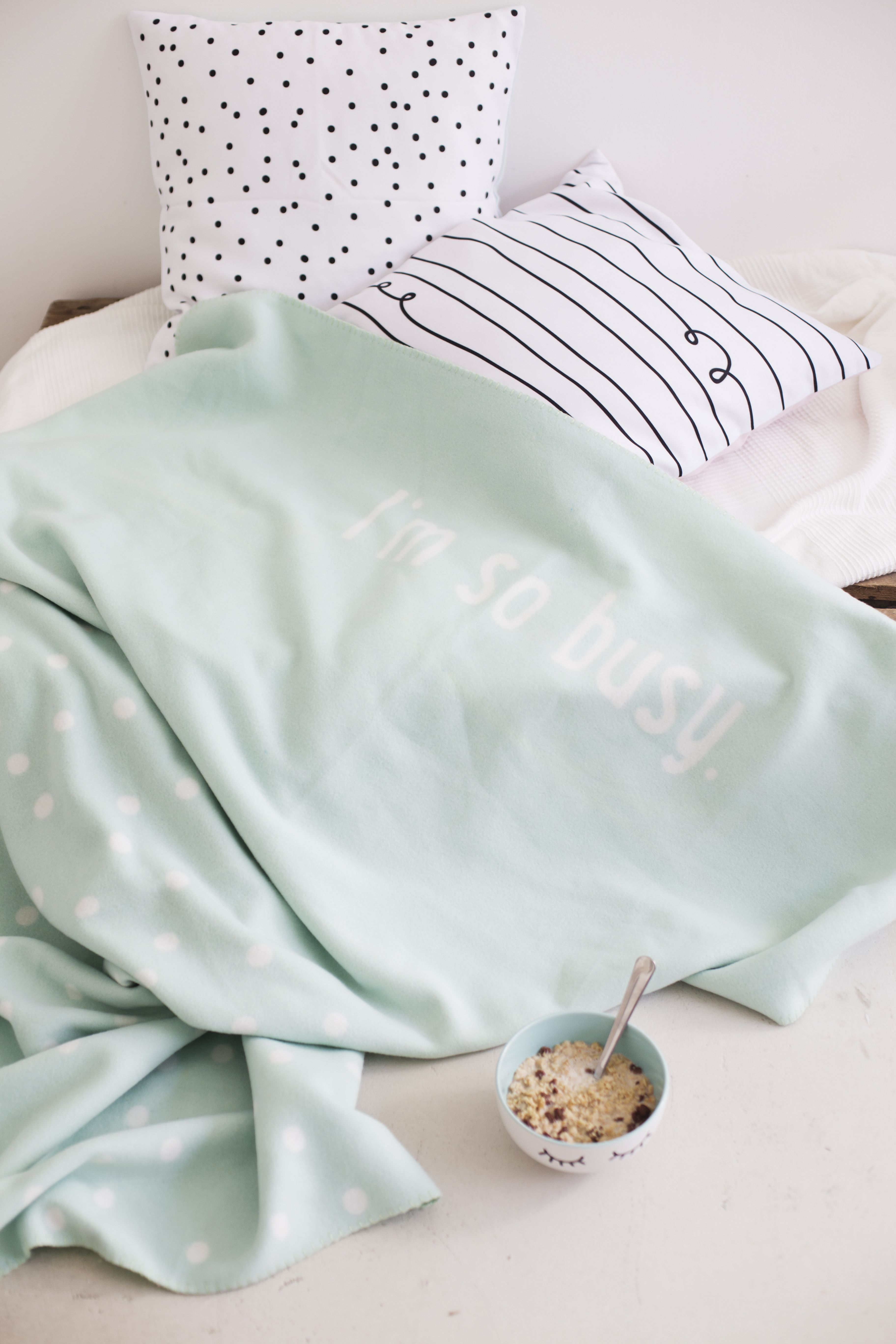 For a cosy day in bed. let'sstayhome, blnaket,pillows,dots.stripes,mint,cereals,bowl,white,black