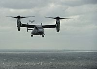 161004-N-VH385-040  ATLANTIC OCEAN (Oct. 4, 2016) An MV-22B Osprey transport aircraft assigned to the Blue Knights of Marine Medium Tiltrotor Squadron (VMM) 365 prepares to land on the flight deck of the aircraft carrier USS George Washington (CVN 73). George Washington, homeported in Norfolk, is underway in the Atlantic Ocean. (U.S. Navy photo by Petty Officer 3rd Class Wyatt L. Anthony/Released)