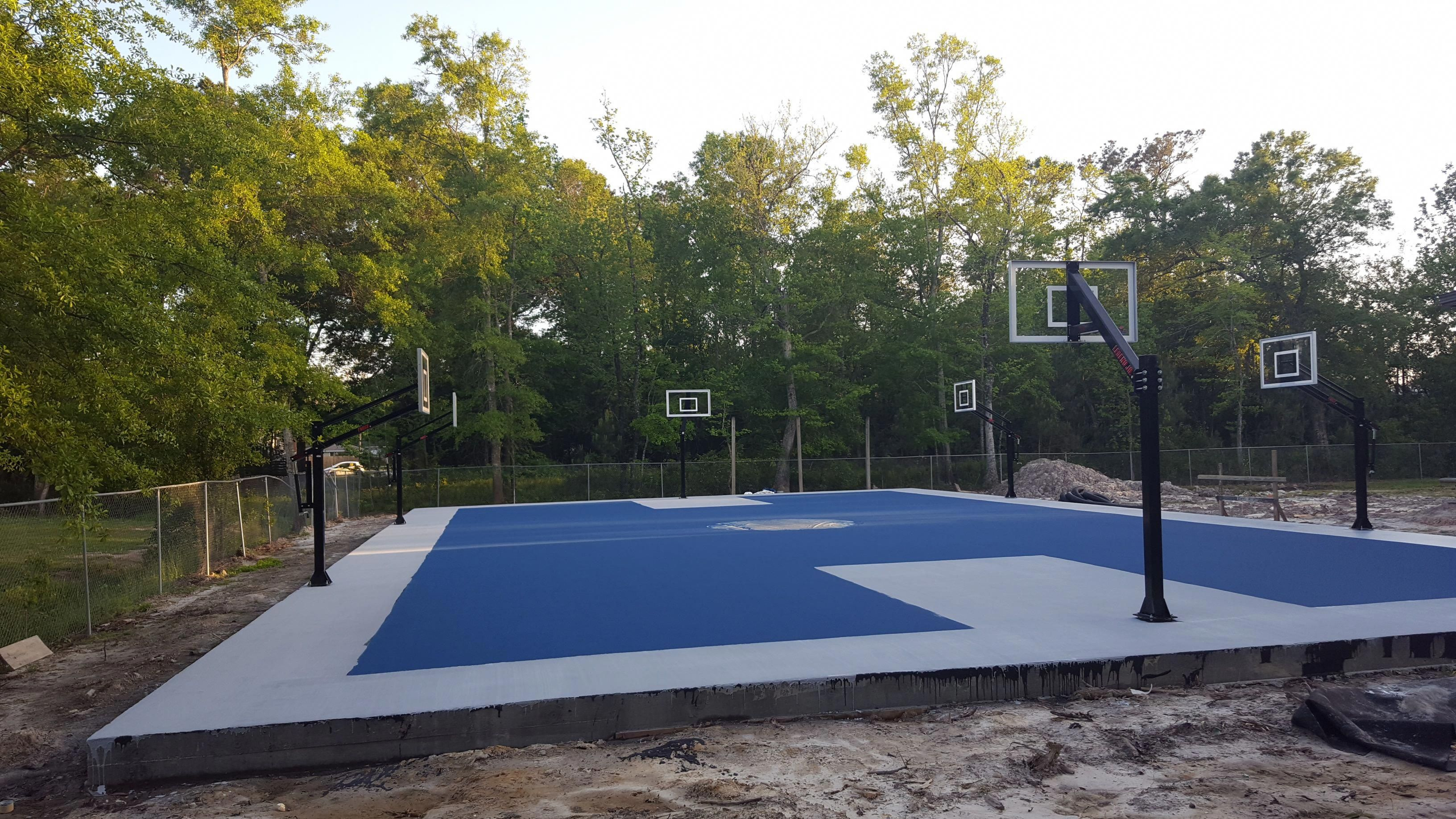 Work In Progress On A New Basketball Court In New Orleans The Court Features Two Legend Jr Fix Basketball Rim In Ground Basketball Goal High School Basketball