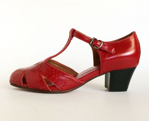A 1920s 1930s Style T Strap In Perforated Patent Leather Featuring A Stacked Leather Heel Patent Leather Uppers With Leather Soles Whole And Half