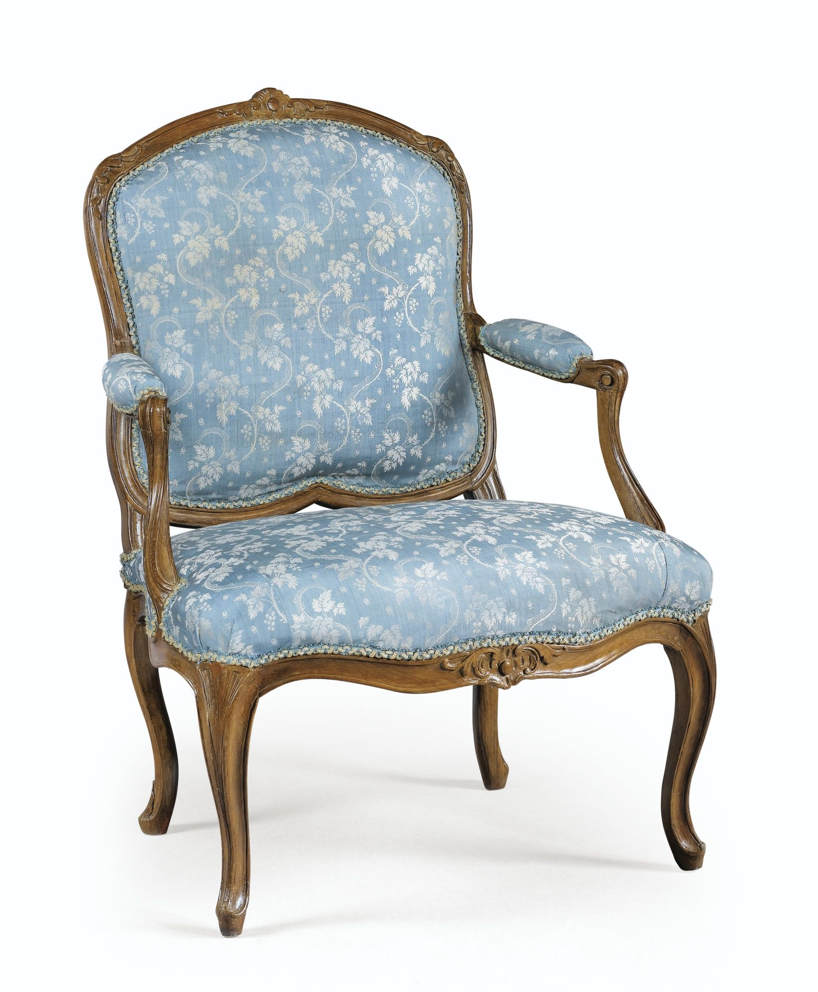 A CARVED WALNUT ARMCHAIR STAMPED TILLIARD, LOUIS XV