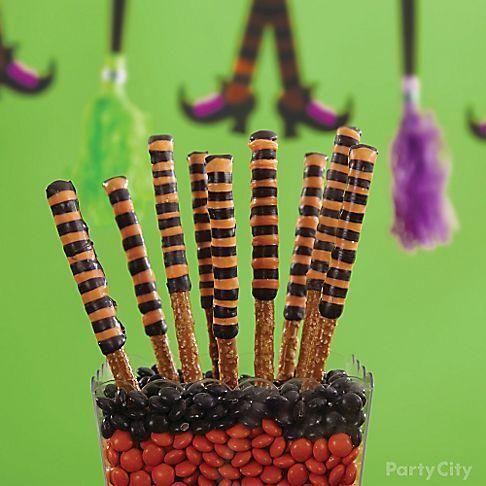 Drizzle black and orange Candy Melts® over pretzel sticks ...