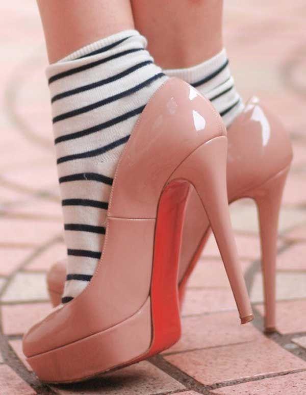 Girl Wearing High Heels With Black White Socks