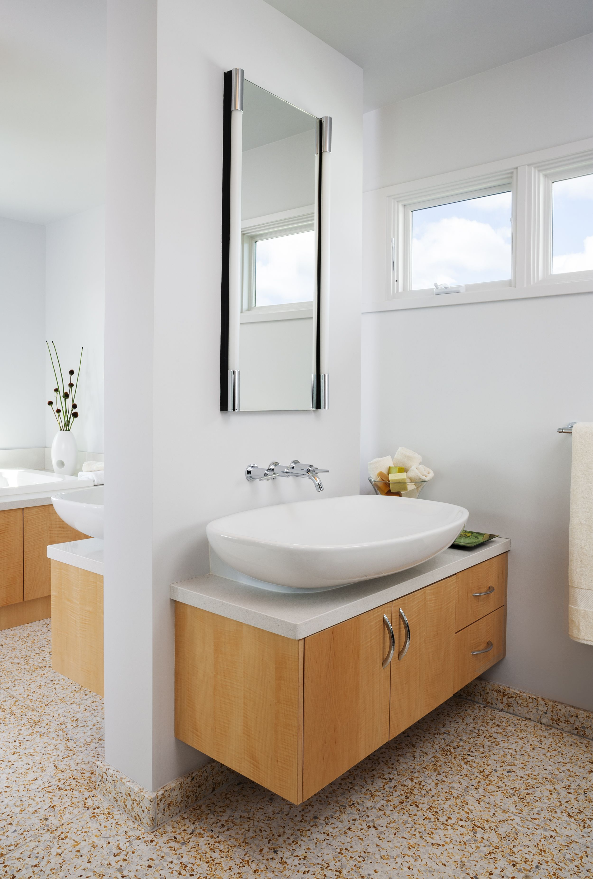 A Warm Bright Color Palette Helps A Small Bathroom Feel More