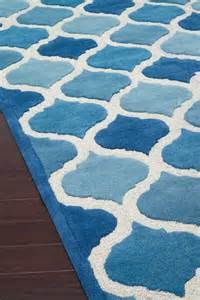 The Loloi Brighton blue area rug is high quality and will add a pop of color to your contemporary home. The geometric designs will stand out and make a statement.