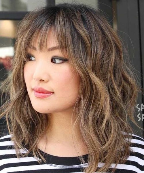 Thick Wavy Hairstyles With Bangs For Women With Medium Hair