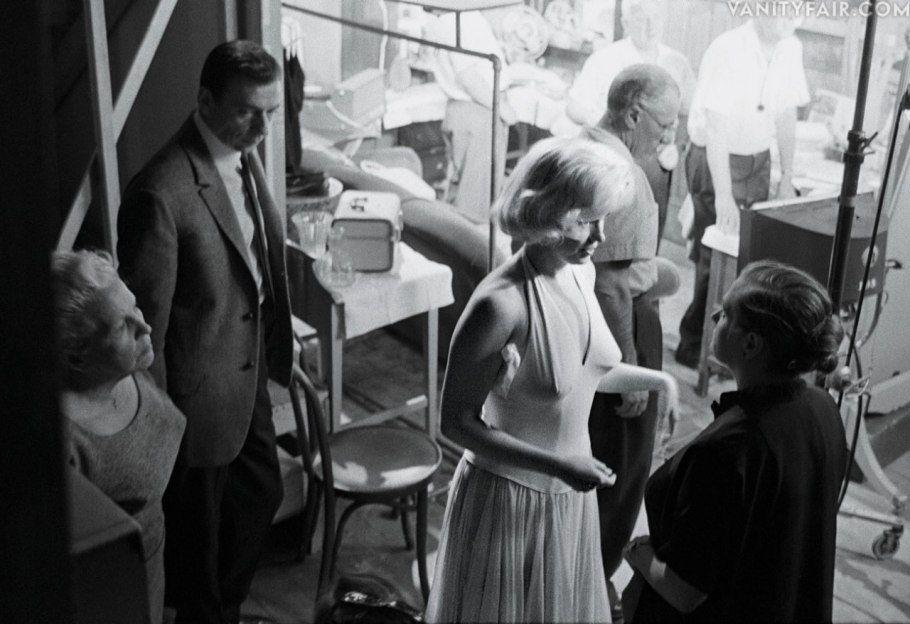 """Marilyn Monroe consulting Paula Strasberg on the set of """"Let's Make Love"""", 1960."""