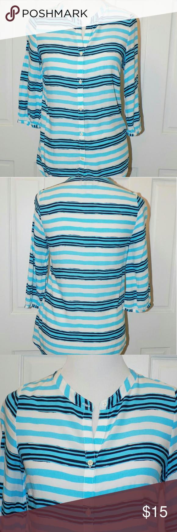 Old Navy Blue Stripped Tunic Blouse 3/4 sleeve Very soft and lightweight. 100% rayon. Buttons down the front. Chest - 18  Length - 26 Old Navy Tops Tunics