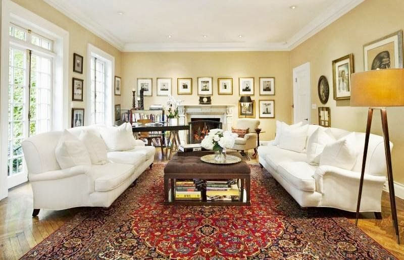 den in nyc home with white dueling sofas persian rugs and