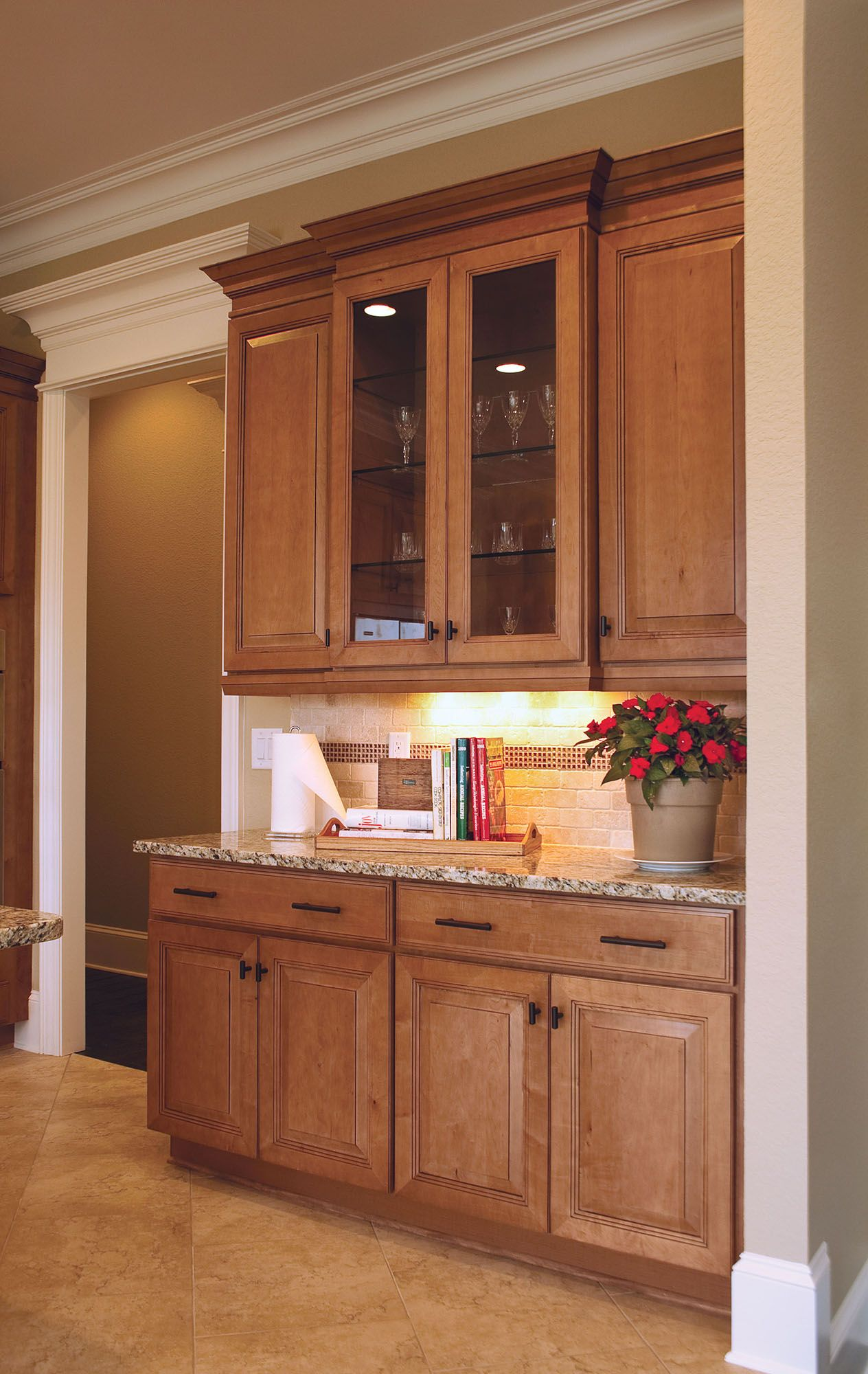 Photo gallery of remodeled kitchen features CliqStudios Carlton Maple Caramel Jute Glaze glass