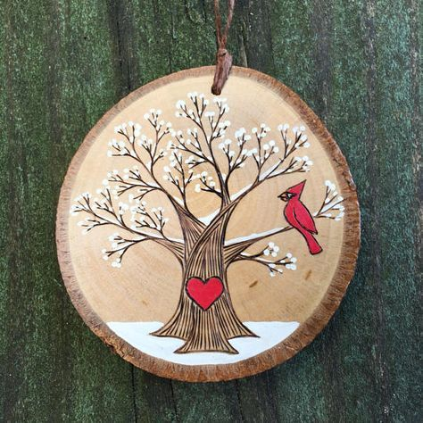 Snowy, winter tree with red cardinal and heart. Cu