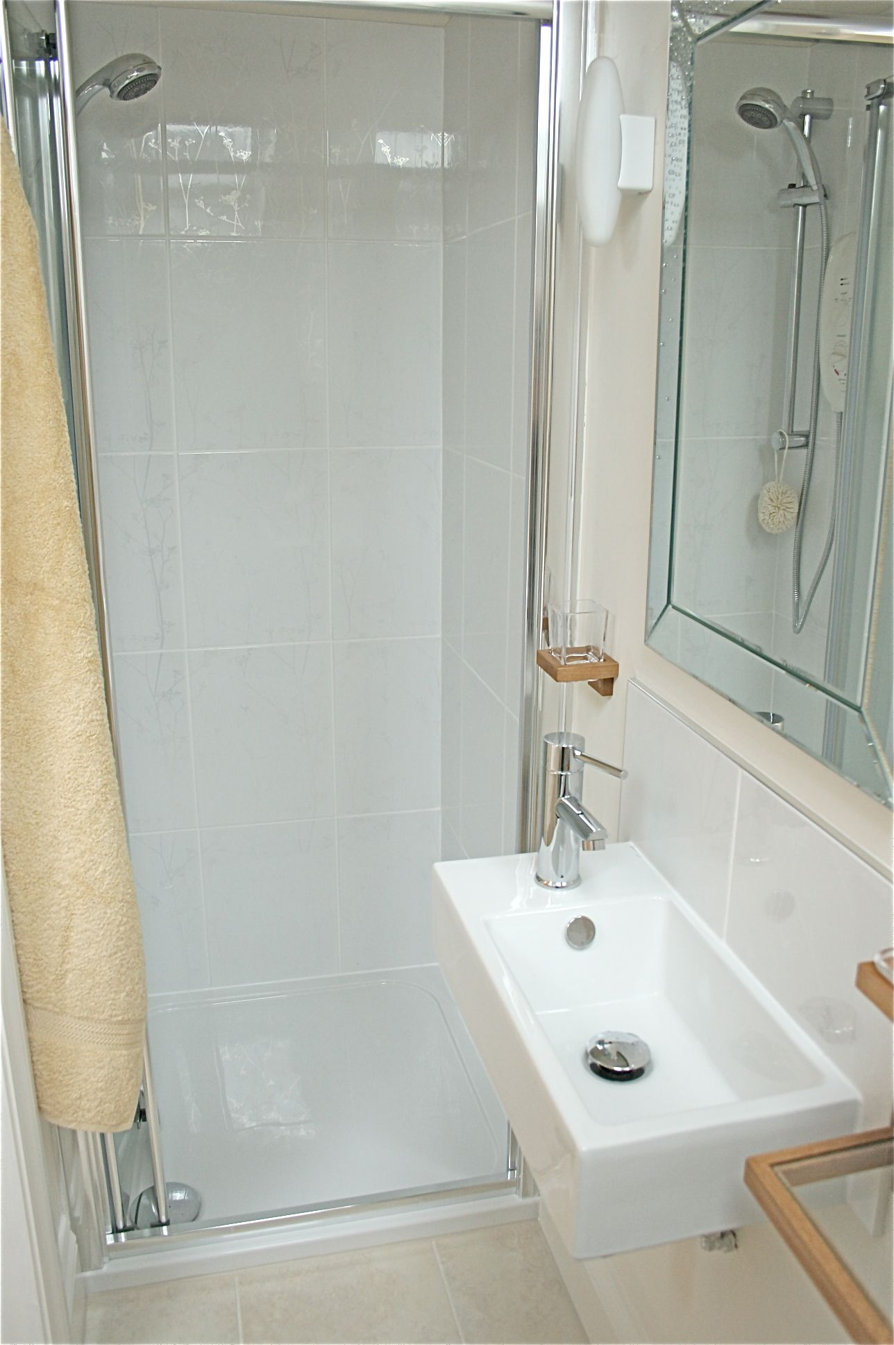 Simple bathrooms with shower - Very Small Bathroom Arragement Idea With Narrow Shower And White Square Sink Accessories Real Simple Bathroom
