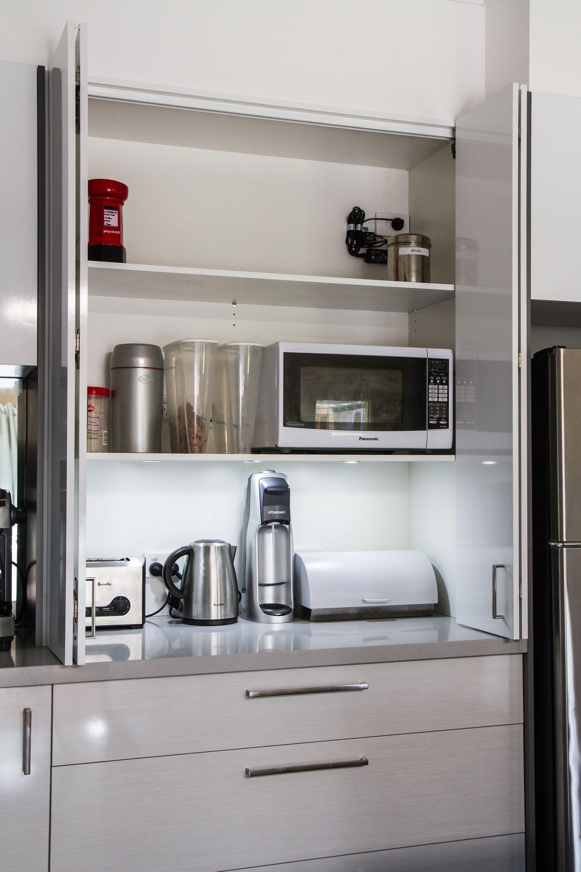Appliance pantry. White modern kitchen. www.thekitchendesigncentre ...