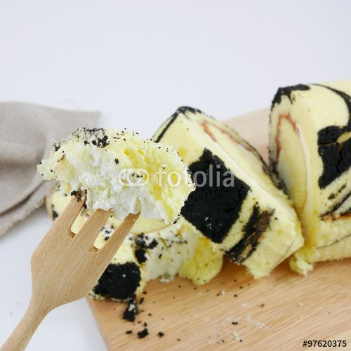 "Download the royalty-free photo ""The yummy blueberry jam roll on the wooden board."" created by phasuthorn at the lowest price on Fotolia.com. Browse our cheap image bank online to find the perfect stock photo for your marketing projects!"