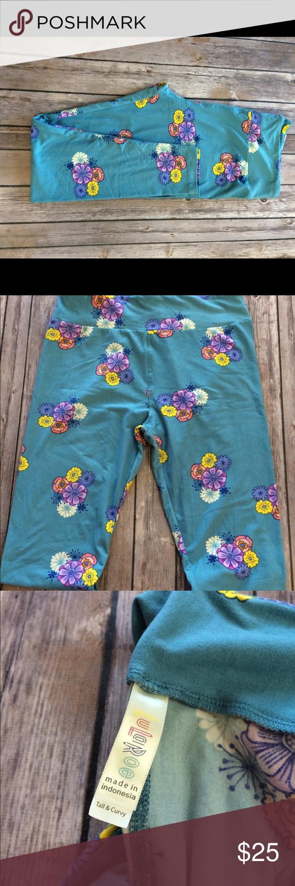 LULAROE TC leggings Blue background with random pink & yellow flowers 🌺. NWOT LuLaRoe Pants Leggings