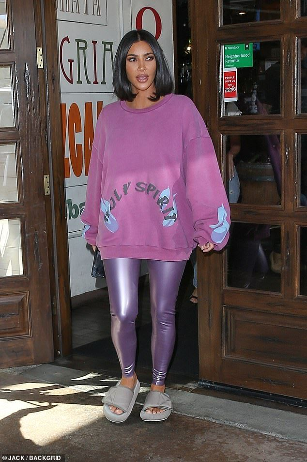 Kim Kardashian covers her gorgeous gams in purple PVC leggings