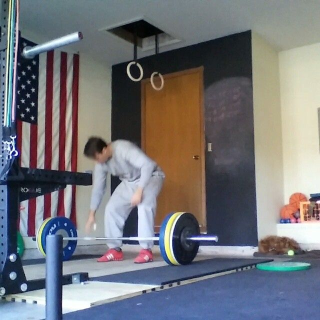 Diy weightlifting platform with squat stand attached workouts
