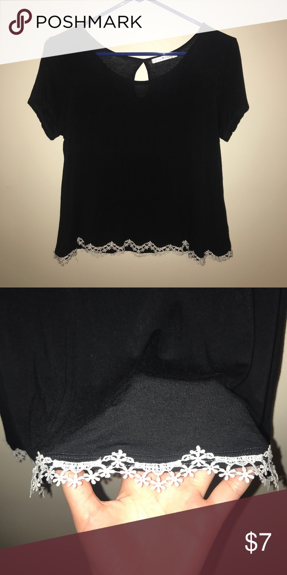 ab6ac316a49b Black T-shirt with lace detailing Black T-shirt with white lace detailing.  Worn once. Size medium but fits more like small. Tops Tees - Short Sleeve