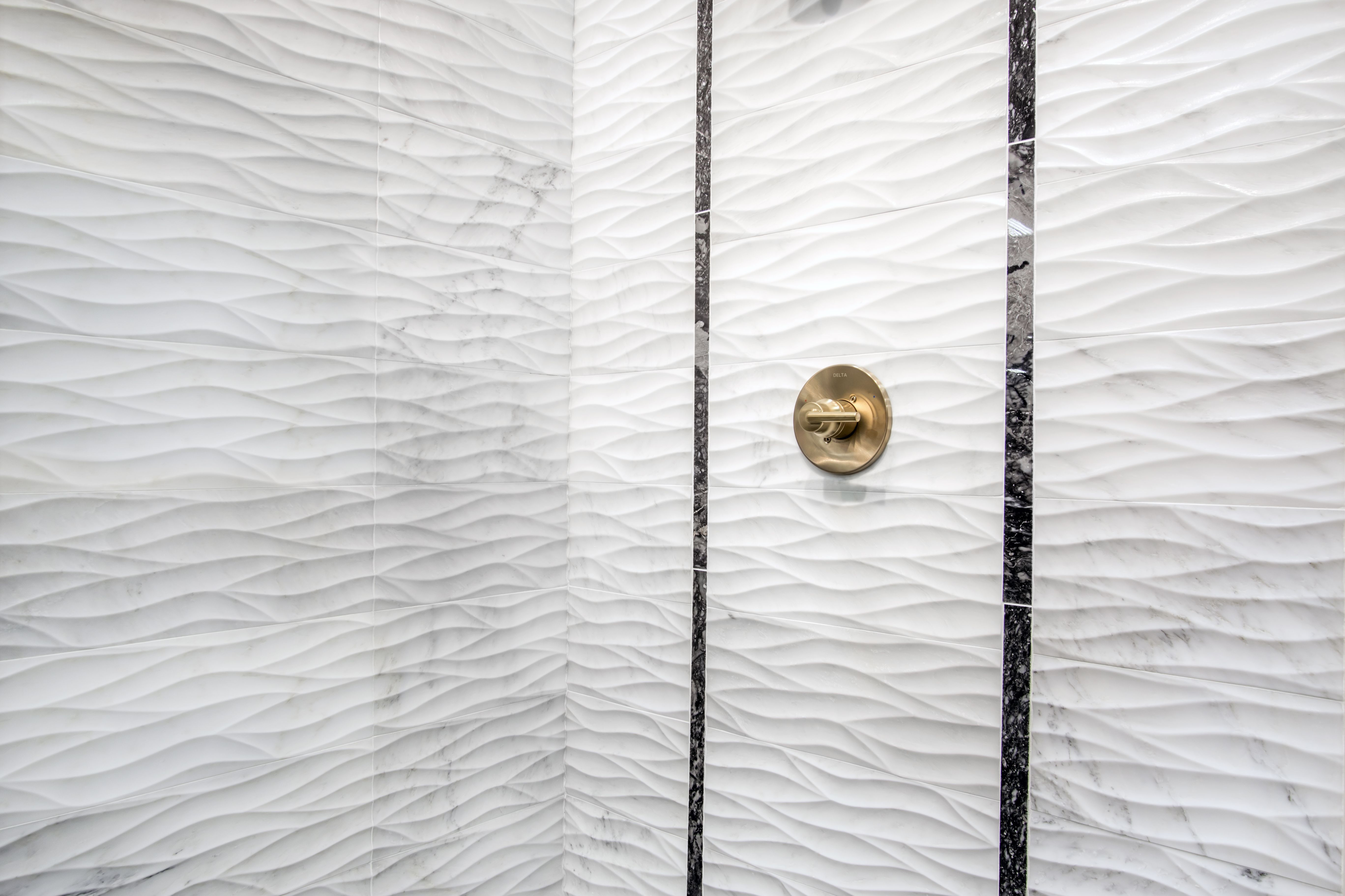 Illuminate Beauty In Waves With This White Carrara Marble