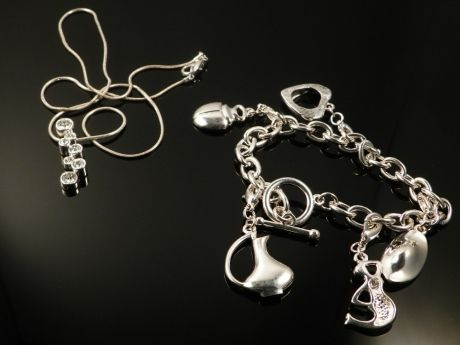 A Swarowski necklace together with a Georg Jensen charm bracelet