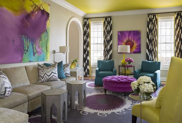 Contemporary living room features a wall lined with a - Purple feature wall living room ideas ...