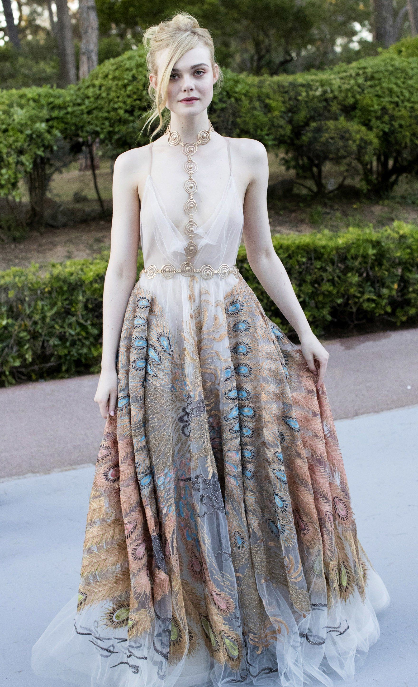 Over the past few months, Fanning has developed her own style aesthetic — this Valentino Couture gown is ethereal, yet with quirky details like a body chain. It's a definite style statement from a girl who's making her name working with Nicolas Winding Refn on a movie about models.