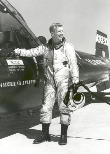 NASA test pilot Joe Walker beside a North American X-15 after a 169,000-foot altitude flight on March 30, 1961. | Photo credit: NASA
