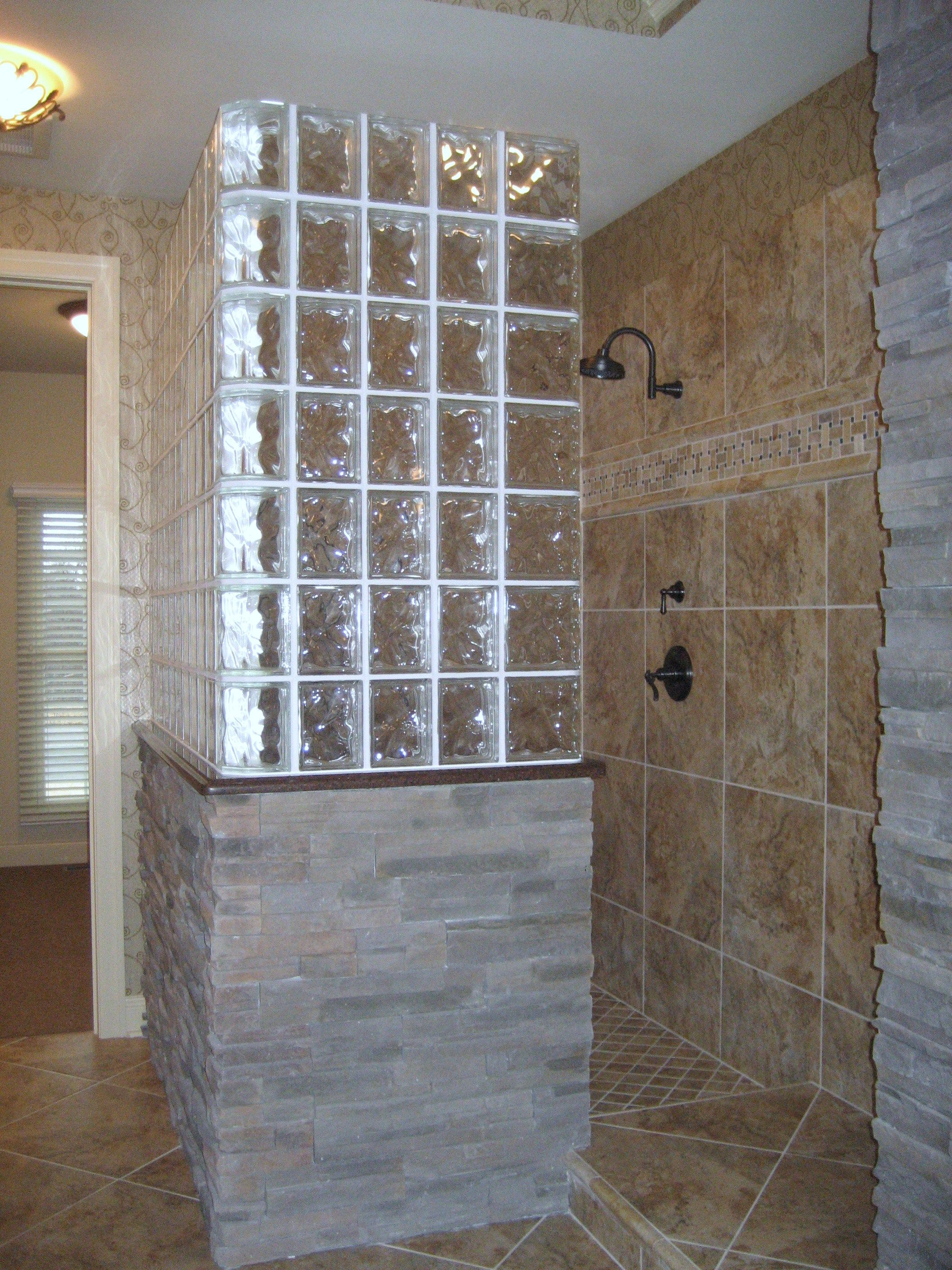A very different look blending glass block, tile and stone ...