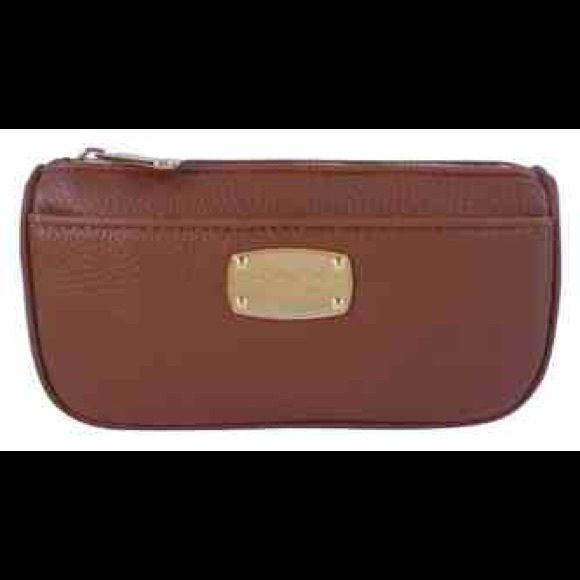 Michael Kors cosmetic bag This is not the actual picture, please let me know if you would like to see more pics Michael Kors Bags