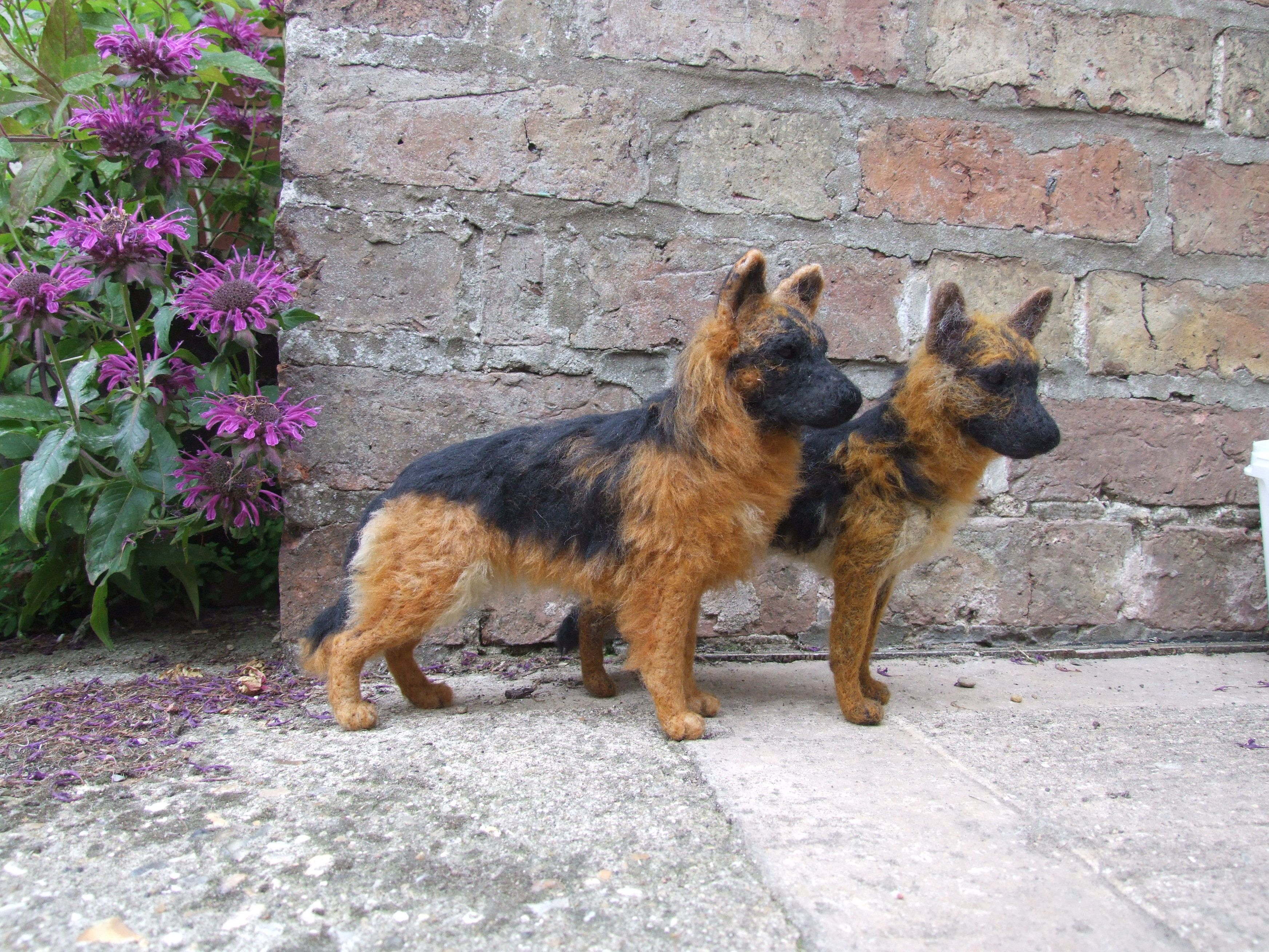 A Couple Of Needle Felted Black And Gold German Shepherds