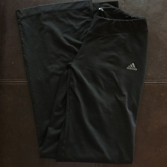 """Black adidas workout pants Very soft and stretchy, dri fit feeling material workout/yoga pants. Inseam measures 31-33"""" so they are pretty long! Very soft and stretchy material to accommodate the most perplexing of yoga maneuvers! They fit like a medium to large, but make a loose comfy medium. The tag has been removed, as well as a small pin hole on right front leg and some wear to back at the bottom from my being so short. Overall though, these pants are in pretty good condition and ready…"""