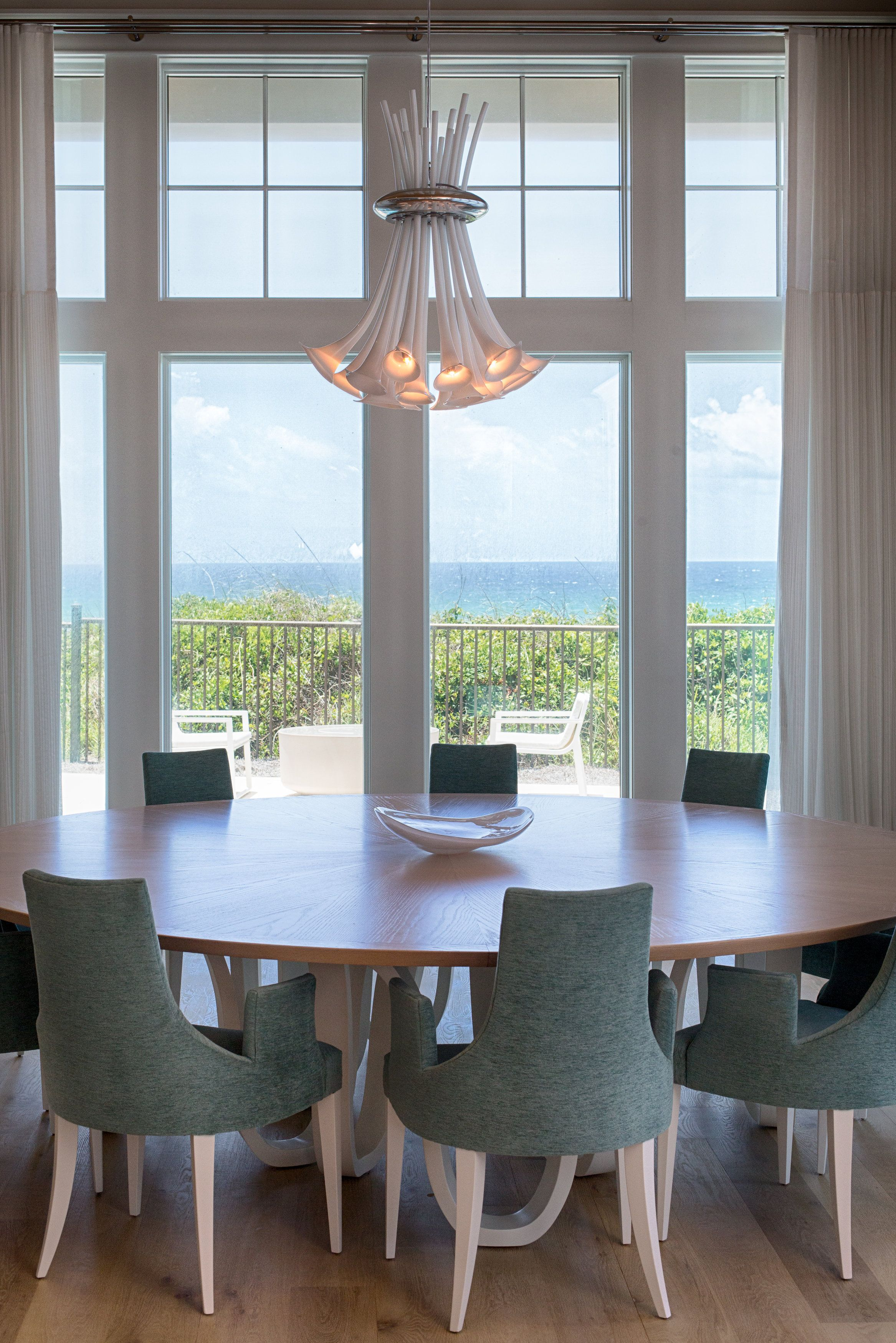 Roundtable Overlooking The Ocean With An Artsy Chandelier Overhead Architect A BOHEME Design Aboheme Follow Us On Instagram Abohemedesign
