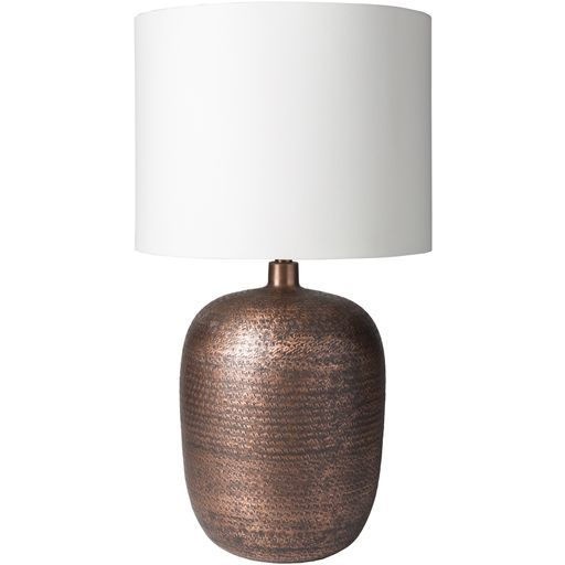 The Yates lamp by Surya offers a warm, metallic look! (YTS