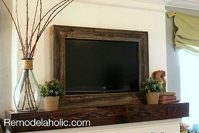 Framing In A Wall Mount TV Helps It Blend With The Rest Of Decor Image Remodelaholic