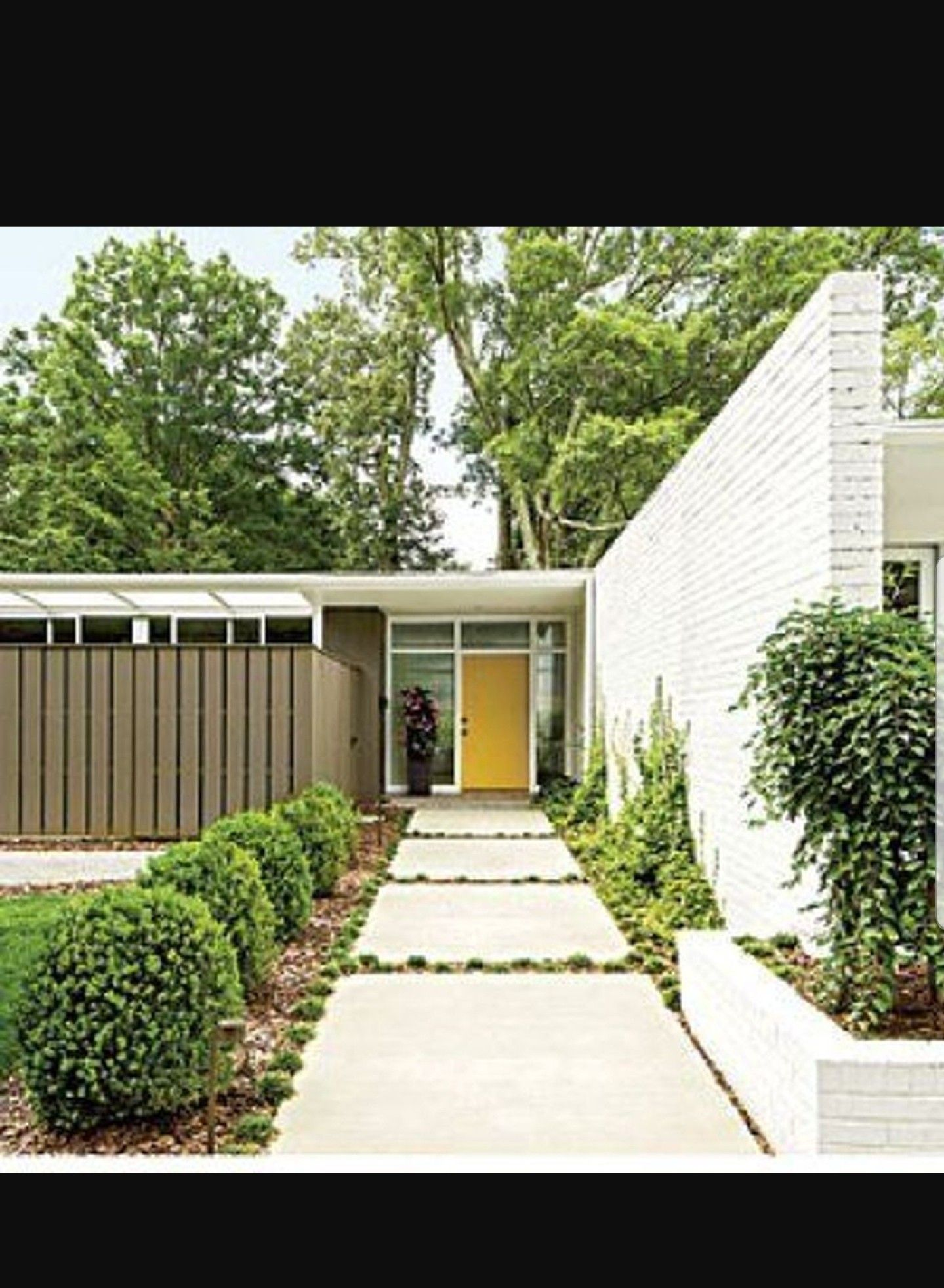 Contemporary Ranch House Remodel Front Entrance Ideas With Walkway Small Yard Green Grass: Tall, Wood Fence Provides Privacy To Large Windows Facing The Street. Yellow Entry Door And