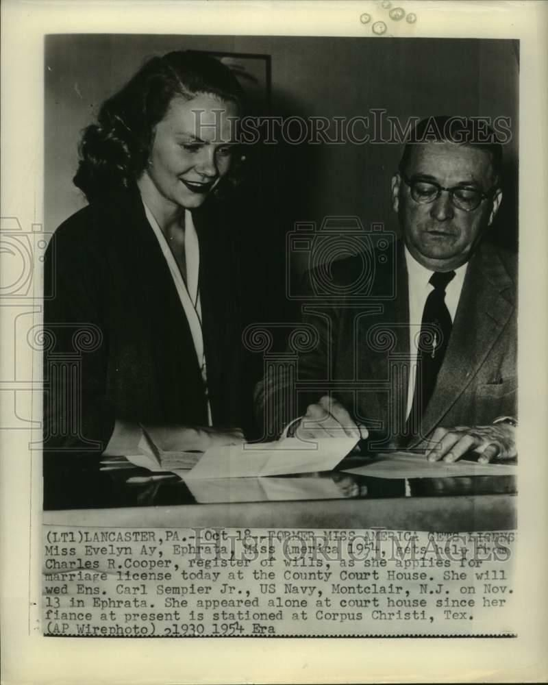 This is an original press photo. She will wed Ens. Carl