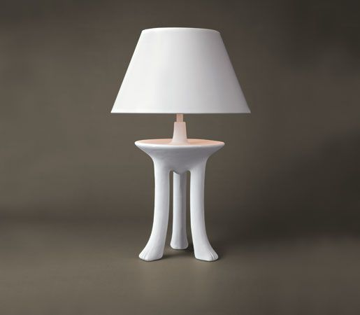 The upcoming fall and winter decor trends are all about white, white, white! Carry this concept into your lighting concepts with this three-footed lamp from Sutherland. Designed by John Dickinson, this contemporary piece will not only light up a room, it will grab attention with its crisp, modern design.
