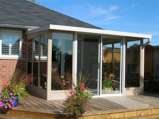 Image Of 3  Season Sunroom Using York Aluminum Porch Enclosure Panels With  Insulated Aluminum Roof
