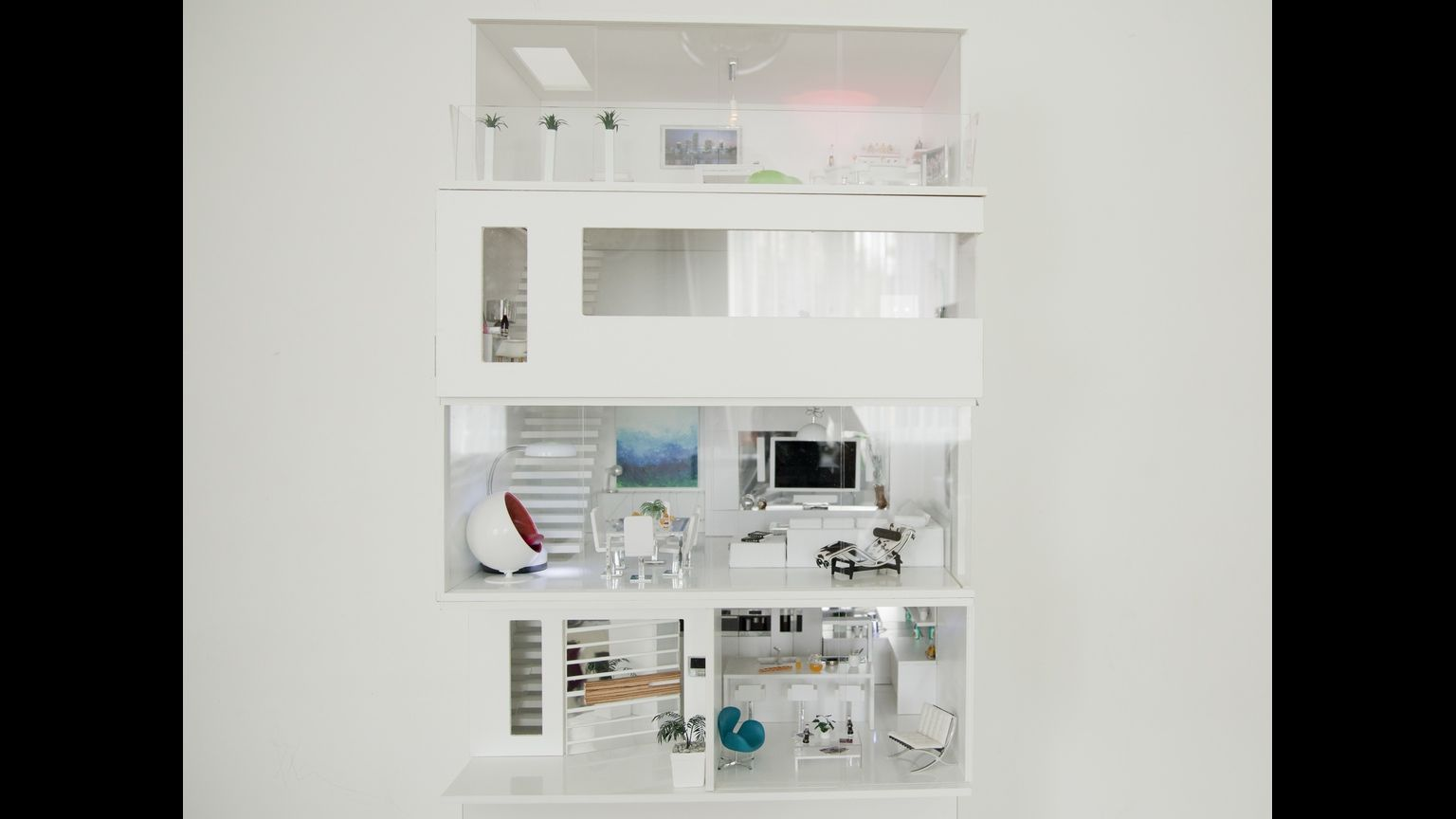 The contemporary Doll's House for adult collectors and children that you buy one floor at a time and stack in the order of your choice.