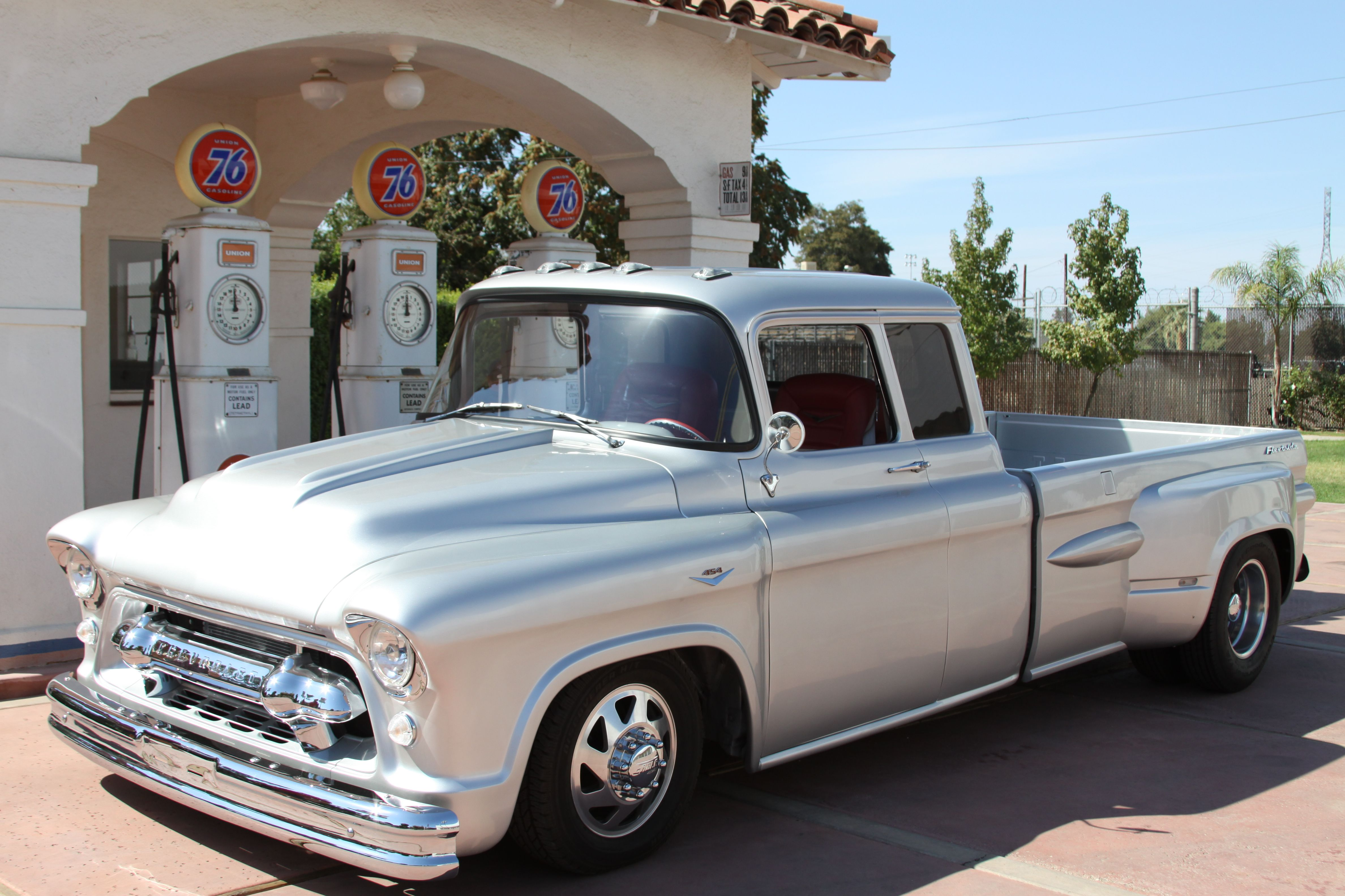 57 chevy pickup truck 1 ton extended cab dually with 454 sitting in front of the vintage union 76 gas pumps at the kern county museum in bakersfield  [ 4752 x 3168 Pixel ]