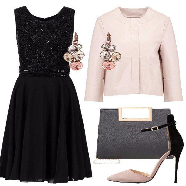 acquista per il meglio moderno ed elegante nella moda molti alla moda Un vestito elegante nero, corto e senza maniche, abbinato a ...