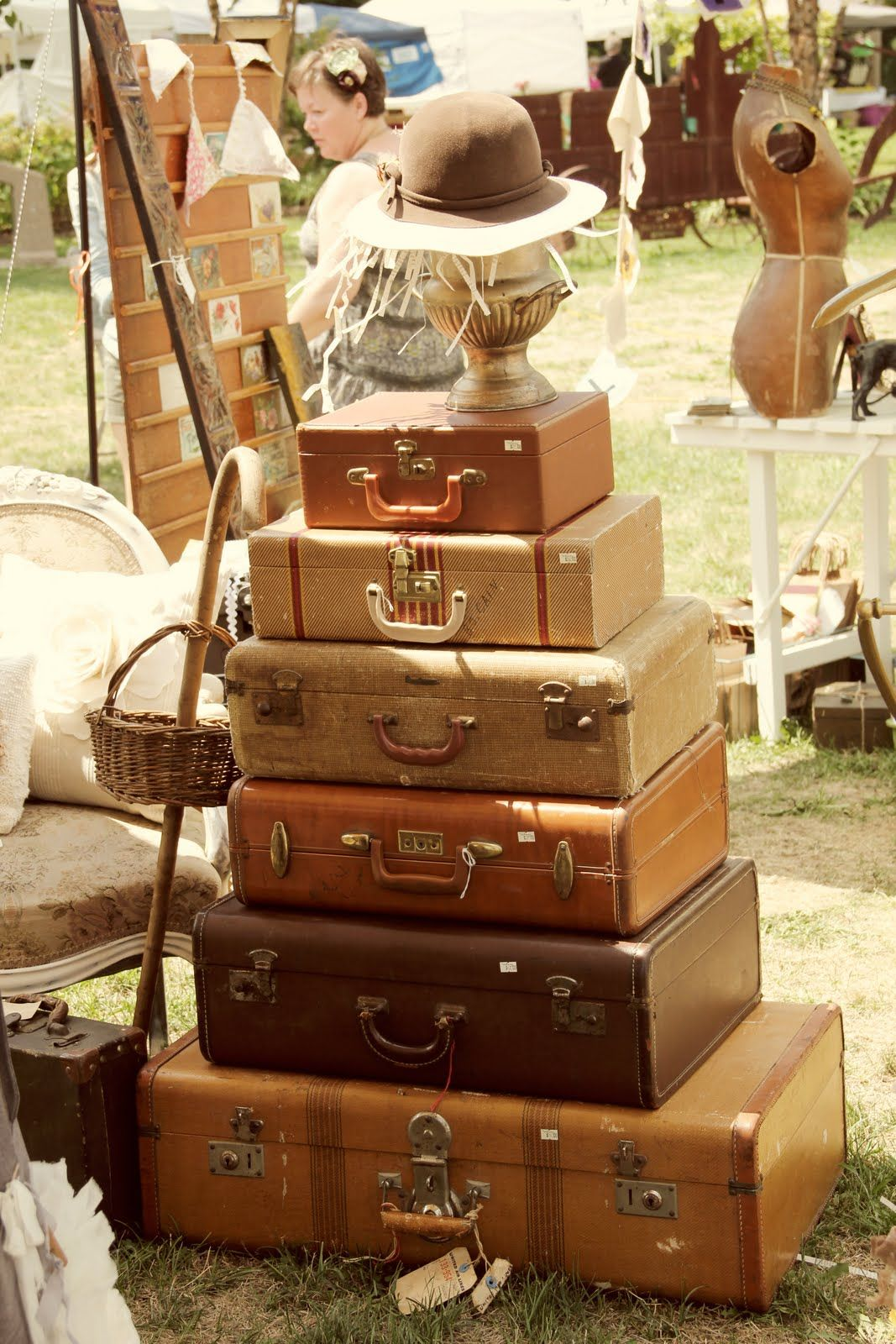 Vintage suitcases for practical storage of off season clothes & decorations...Could be storage for unit based materials (stuff you don't use everyday)
