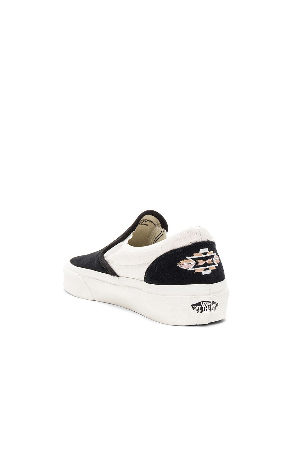 648afa10ae Vans Native Embroidery Classic Slip-On in Black   Marshmallow ...