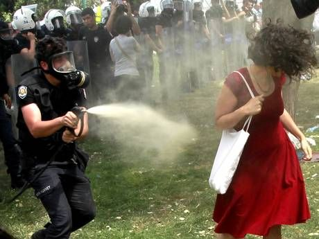 Istanbul, 28 May, woman in a red dress Ceyda Sungur, being sprayed with tear gas - focal image of the unrest in Turkey