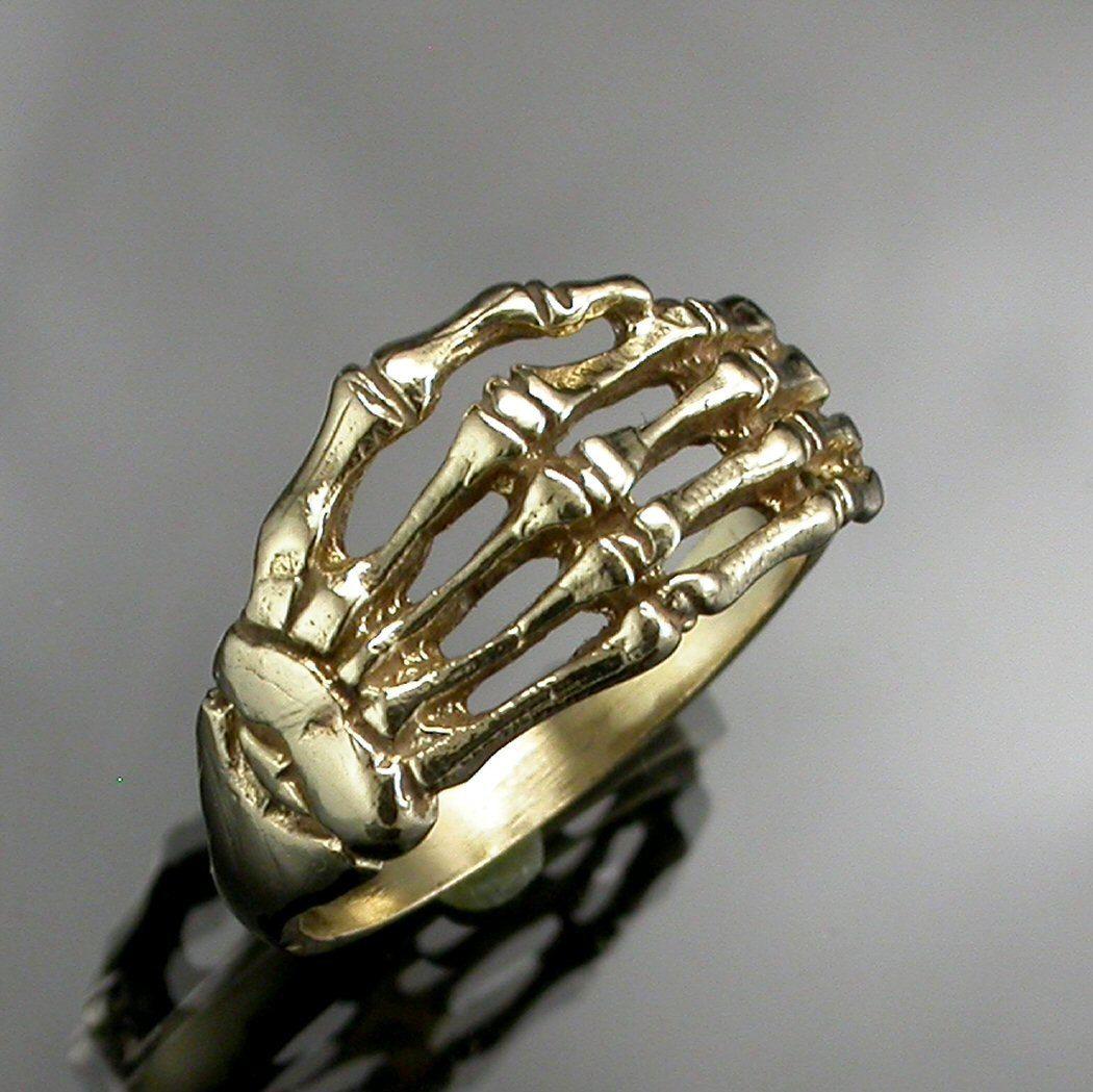 Skeleton Hand Ring, via Etsy.