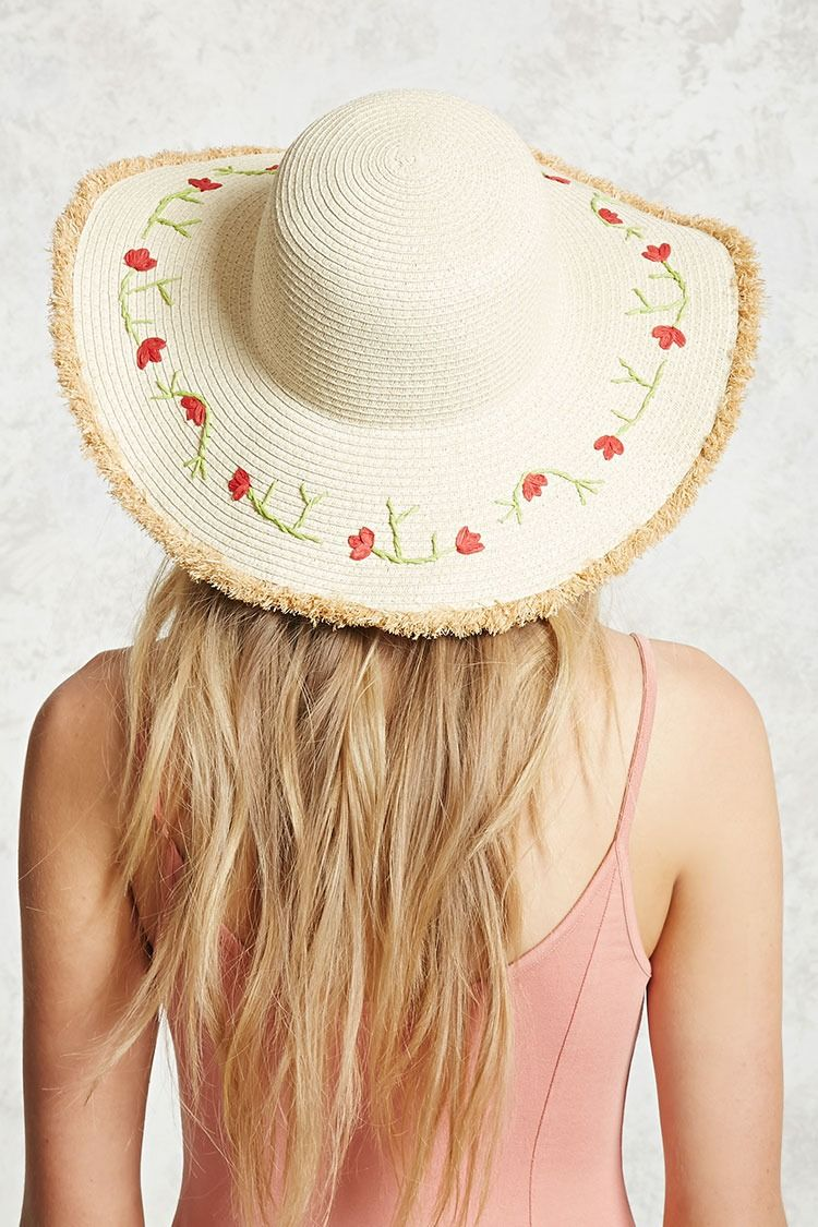 6e673415d15 A woven straw hat featuring a floral embroidery