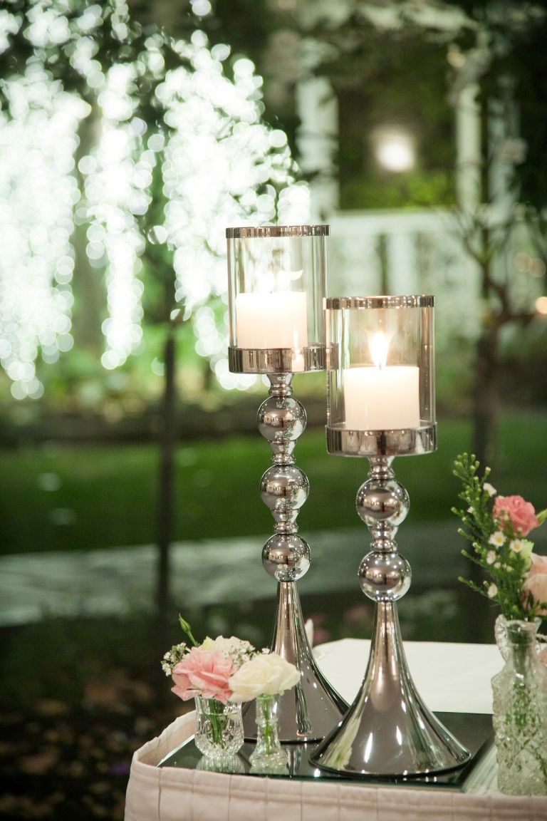 Our new tiered silver stands with candles gorgeous