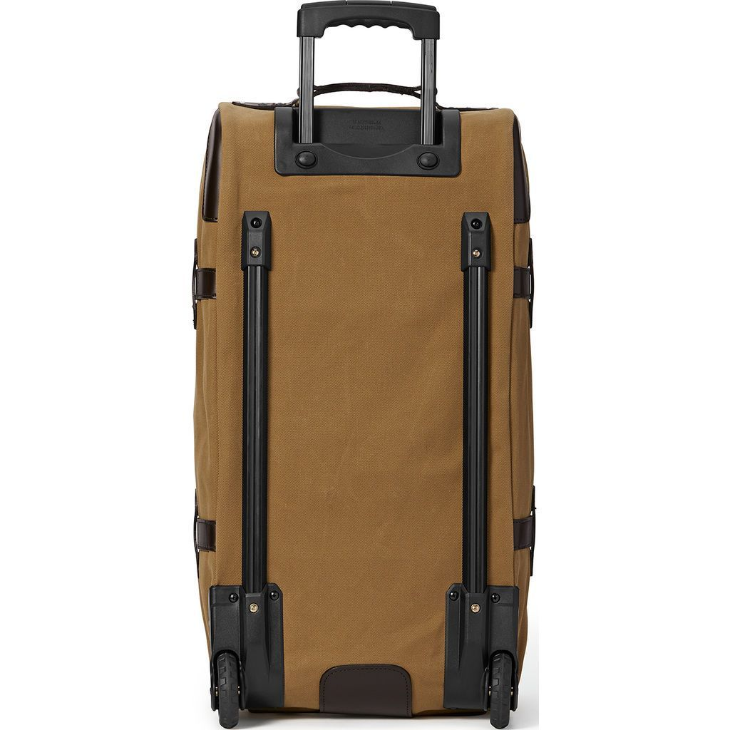 1400a697dbd Filson has a long standing reputation for their high quality heavy-duty  travel bags. The Tan Large Rolling Duffel has a huge capacity and is as  durable as ...