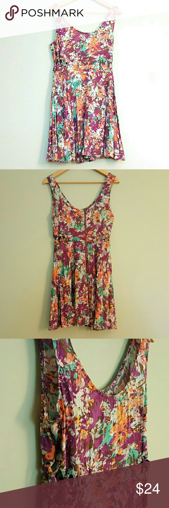 Lucca Couture Laced Side Cutout Floral Dress 8 This fun dress features laced up cutouts on the side and a flared skirt. It is in good pre-owned condition with only minor signs of wear. Size 8. Lucca Couture Dresses Mini